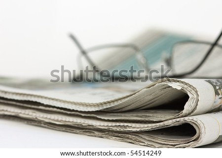 Spectacles on Newspaper - stock photo