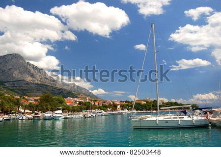Spectacular clouds over Baska Voda on Adriatic coast in Croatia - stock photo