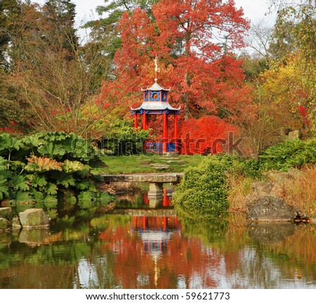 Spectacular colored Maples in a Japanese style garden with pond and pagoda shaped arbour - stock photo