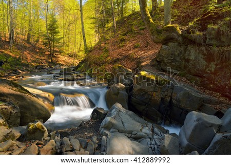 Spectacular creek in spring forest. Hiking in Carpathian Mountains. - stock photo
