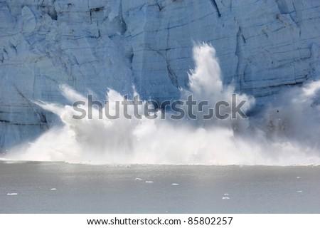 spectacular glacier calving - stock photo