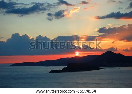 Spectacular moody scenic sunset over Budva, Montenegro - stock photo