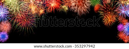 Spectacular multi-colored fireworks as a panoramic arch shaped border on black background, ideal for New Year or other celebration events - stock photo