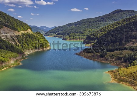 Spectacular natural scenery with turquoise artificial dam lake on the Buzau river valley, Romania. - stock photo