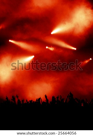 spectacular red light show, silhouette of concert crowd - stock photo