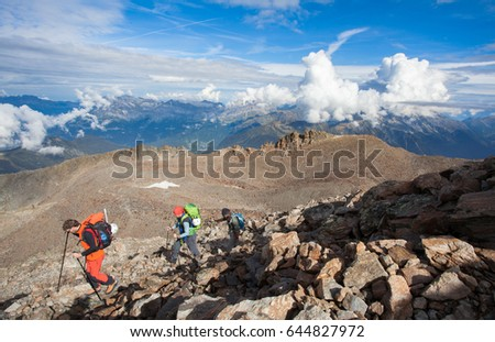 Spectacular view of Alp mountains with people climbing Mont Blanc - the highest summit of Europe from France.