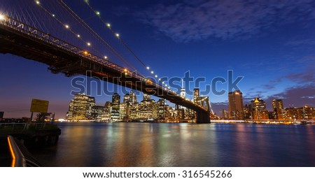 Spectacular view of Manhattan by night from Brooklyn, New York City - stock photo