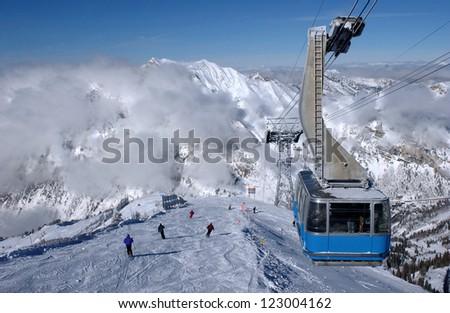 Spectacular view to the mountains and blue ski tram at Snowbird ski resort in Utah - stock photo