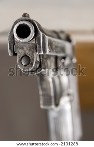 Spectator-aimed gun - stock photo