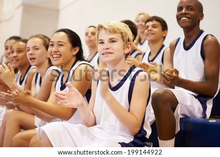 Spectators Watching High School Basketball Team Match - stock photo