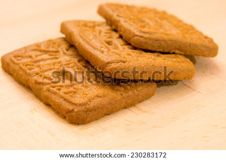 Speculoos biscuits on wooden background - stock photo