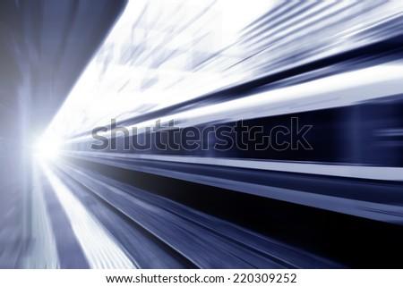 Speed blur railway track at station. - stock photo