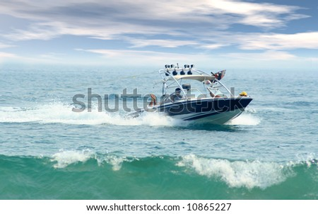 Speed boat cruising through ocean waves - stock photo
