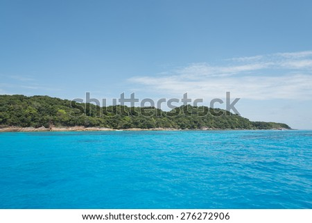 speed boat float over very clear transparent blue sea turquoise and emerald colored can see many reef under water - stock photo
