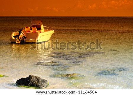 Speed Boat Moored In The Caribbean Sea Ready For Deep Sea Fishing - stock photo