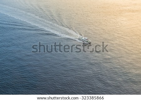 Speed boat on the sea at sunset time. - stock photo