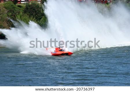 Speed boat racing through water - stock photo