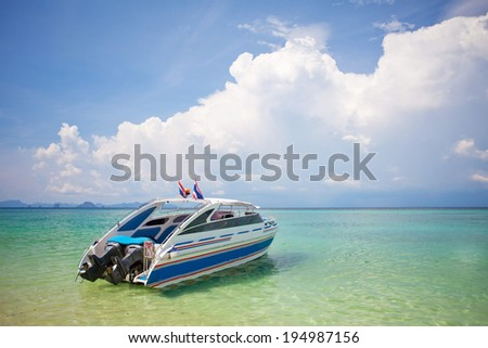 Speed Boat with blue sky - stock photo