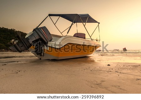 Speed boat with sunset background - stock photo