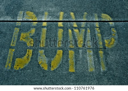 speed bump sign painted on the road - stock photo