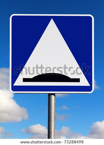 Speed bump (sleeping policeman) traffic sign on a sky background - stock photo