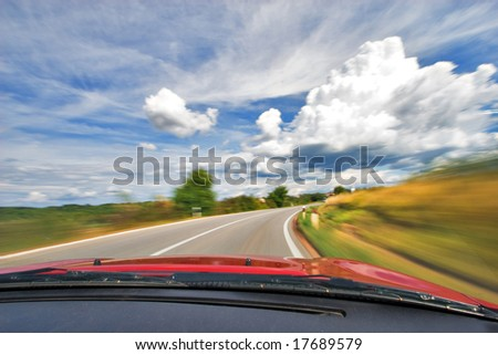 Speed Fast Sport Car Driving in Curve on Nature Freeway - stock photo