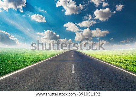 speed highway through the field. asphalt-paved road - stock photo