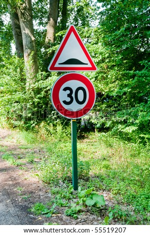Speed limit and speedbump road sign - stock photo