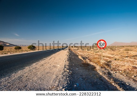 Speed limit sign 100 km per hour at the road - stock photo