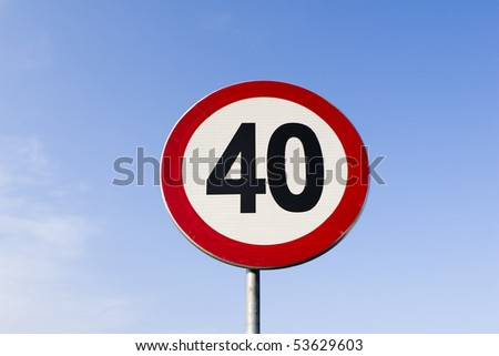 speed limit sign with blue sky background.