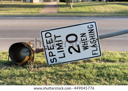 Speed limit sign wrecked in car accident - stock photo