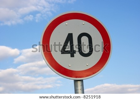 Speed limit traffic sign against blue sky