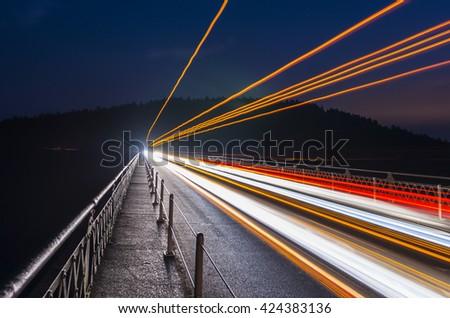 speed of  car light on the bridge at night. - stock photo