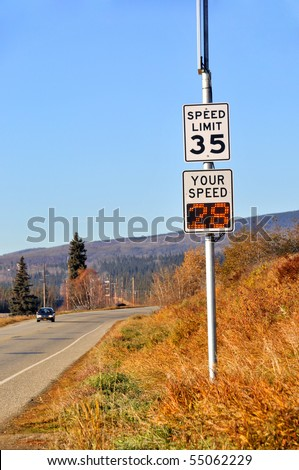 Speed sign with electronic speed monitor - stock photo