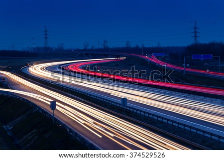 Speed traffic light trails on motorway M0 to Budapest in Hungary.Long exposure - stock photo