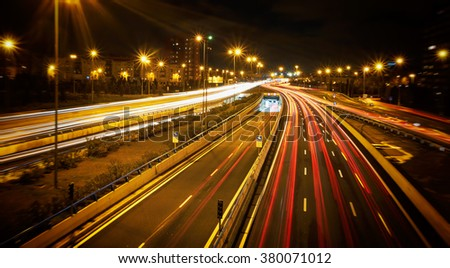 Speed Traffic, Madrid, Spain- light trails on motorway highway at night, long exposure abstract urban background. - stock photo