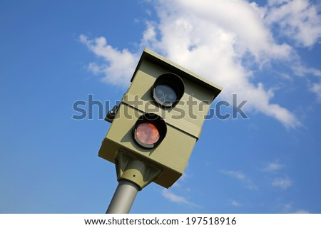 speed trap against blue sky - stock photo