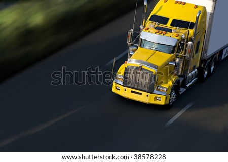 speed yellow semi-truck on highway - stock photo