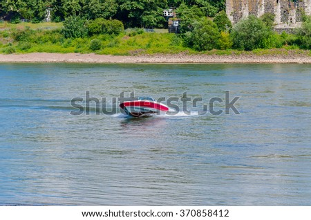 Speedboat cruising in the lake.