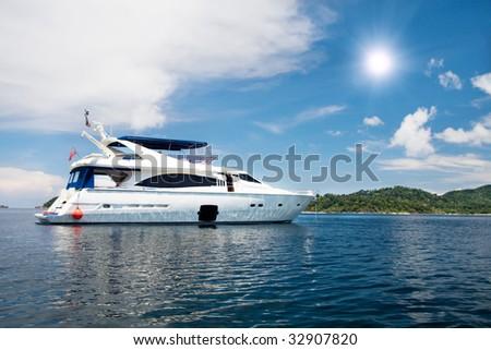 speedboat cruising in tropical sea - stock photo