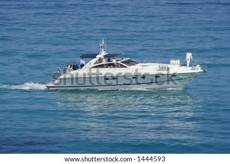 speedboat in action - saint-tropez, french riviera, mediterranean sea - stock photo