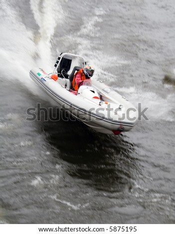Speedboat racing along on a river