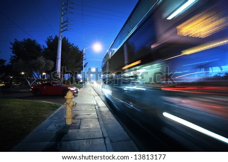 Speeding bus, blurred motion. Las Vegas Blvd., Las Vegas, USA. - stock photo