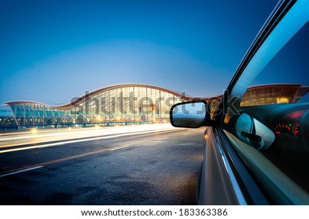 speeding car go through the city . - stock photo