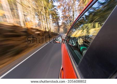speeding car with motion blur background. - stock photo