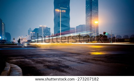 speeding lights of cars in city at night. - stock photo