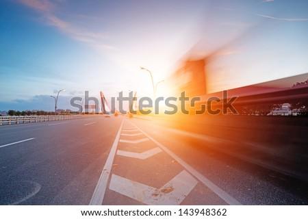 speeding truck go through the bridge - stock photo