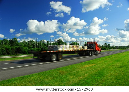 Speeding truck on highway, blurred because of motion - stock photo