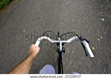 Speeding with the bicycle - stock photo