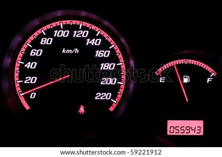 Speedometer and fuel gauge - stock photo